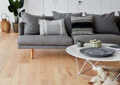 coffee table and grey lounge on bespoke timber flooring sunshine coast